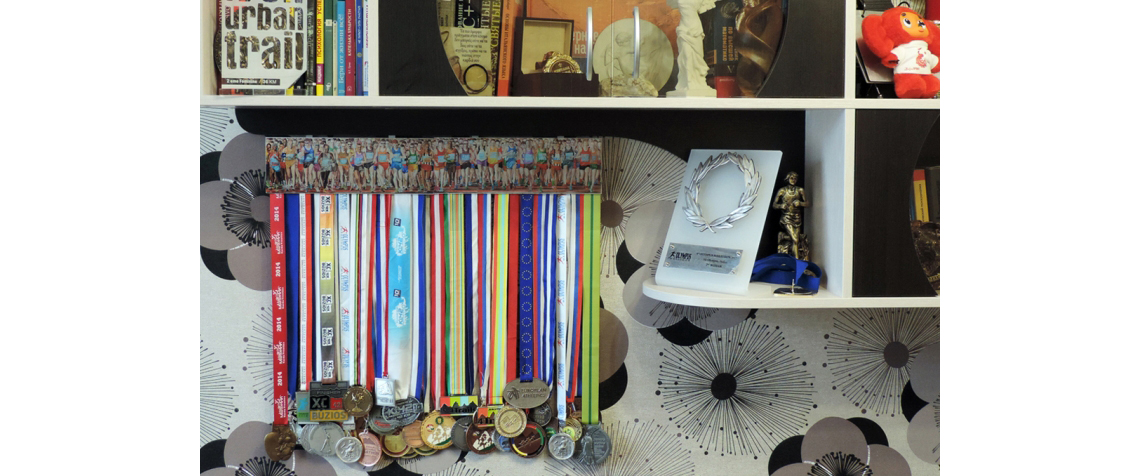 Two medal displays with medals in the interior and the picture is the start of the marathon