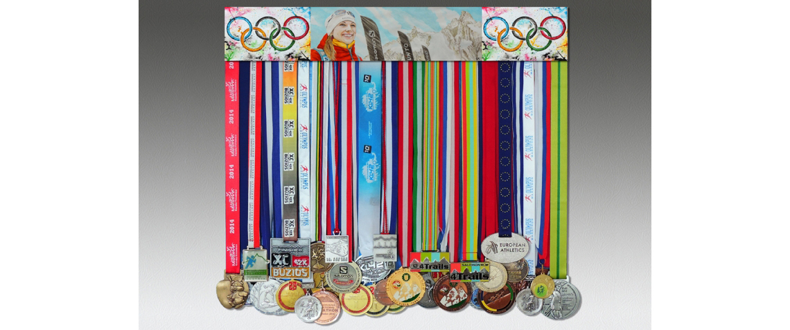 Medal holder with medals and a picture skayraner Zhanna Vokueva and Olympic rings