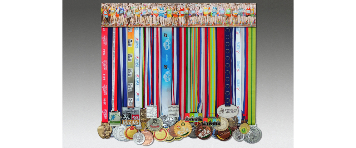 Medal display and medals and a picture of the marathon start